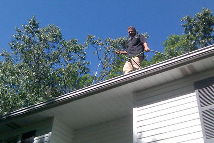 Craig Colombero cleaning gutters.